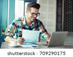 man is doing his freelance job... | Shutterstock . vector #709290175