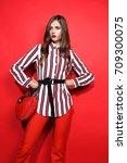 fashion portrait of beautiful... | Shutterstock . vector #709300075