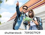 happy asian couple tourist... | Shutterstock . vector #709307929