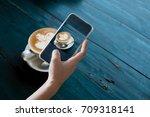 hand holding mobile smart phone ... | Shutterstock . vector #709318141