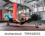 athletic couple training on row ... | Shutterstock . vector #709318231