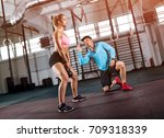 fitness woman doing squats with ... | Shutterstock . vector #709318339