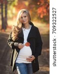 young pregnant woman walking in ... | Shutterstock . vector #709322527