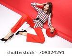 fashion portrait of beautiful... | Shutterstock . vector #709324291