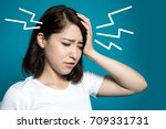 Young Woman Having A Headache.