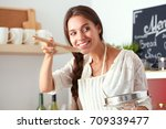 cooking woman in kitchen with... | Shutterstock . vector #709339477