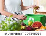 woman recycling organic kitchen ... | Shutterstock . vector #709345099