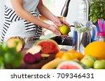 healthy woman washing an apple... | Shutterstock . vector #709346431