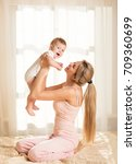 mother and baby playing and... | Shutterstock . vector #709360699