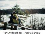 joyful cute couple in warm... | Shutterstock . vector #709381489