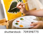 artist's hand with brush and... | Shutterstock . vector #709398775
