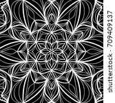 floral mehendi pattern.  ... | Shutterstock . vector #709409137