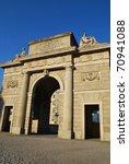 Ancient city entrance Porta Garibaldi gate on blue sky, Milan, Lombardy, Italy - stock photo