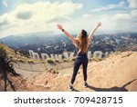 Small photo of Young woman at the top of Hollywood, Los Angeles, California