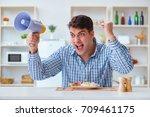 husband with loudspeaker... | Shutterstock . vector #709461175