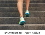 woman walking up the stairs ... | Shutterstock . vector #709472035