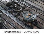 smoking death with skull shadow ... | Shutterstock . vector #709477699