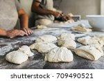 baker preparing bread. close up ... | Shutterstock . vector #709490521