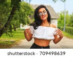 beautiful eyes in a dark haired ... | Shutterstock . vector #709498639
