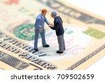 handshaking businessmen on usa... | Shutterstock . vector #709502659