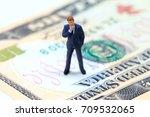 businessman figurine on usa... | Shutterstock . vector #709532065