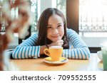 asian woman smile with hot... | Shutterstock . vector #709552555