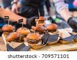 chef making beef burgers... | Shutterstock . vector #709571101