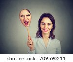 happy smiling woman taking off... | Shutterstock . vector #709590211