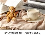 cup of tea with book on table... | Shutterstock . vector #709591657