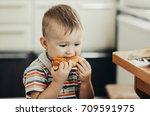 wonderful little child eating a ... | Shutterstock . vector #709591975