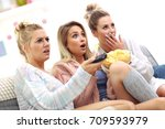 three beautiful young women... | Shutterstock . vector #709593979