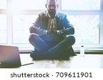 businessman doing yoga in lotus ... | Shutterstock . vector #709611901