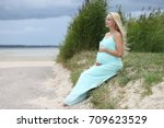 pregnant young girl with a big...   Shutterstock . vector #709623529
