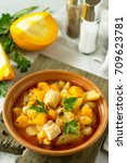 Small photo of Turkey stew with pumpkin, vegetables and spices in a bowl on a stone background.