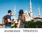 a couple of tourists a young... | Shutterstock . vector #709635151