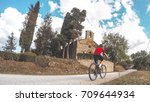 cycling in tuscany countryside. | Shutterstock . vector #709644934