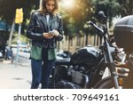 girl in leather jacket holding... | Shutterstock . vector #709649161