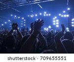 concert goers applauding inside ...   Shutterstock . vector #709655551
