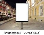 blank street billboard at night ... | Shutterstock . vector #709657315