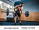 strong bearded tattooed man at... | Shutterstock . vector #709671709