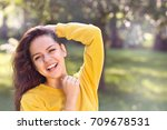 young pretty girl in autumn or... | Shutterstock . vector #709678531