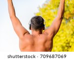 fit man exercising at the park  ...   Shutterstock . vector #709687069