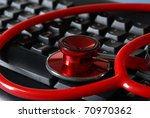 A stethoscope on a keyboard for medical conceptions. - stock photo