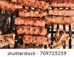 romanian barbecue  mici ... | Shutterstock . vector #709725259
