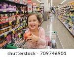 happy little customer girl... | Shutterstock . vector #709746901