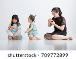 asian child with mother  shot... | Shutterstock . vector #709772899