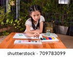 a little girl is learning to...   Shutterstock . vector #709783099