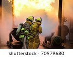 three firefighters advance with ... | Shutterstock . vector #70979680