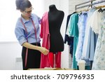 young talented seamstress... | Shutterstock . vector #709796935