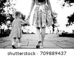 mom and daughter are holding... | Shutterstock . vector #709889437